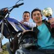 Man stood with motorbike and trophy — Stock Photo #7677654