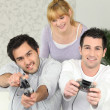 Foto Stock: Friends playing video games