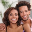 Young couple relaxing at home — Stock Photo