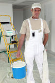Painter carrying large pot of paint — Stock Photo