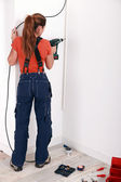 Female laborer with power drill — Stock Photo