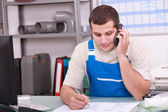 Craftsman in office on phone — Stock Photo