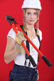 Woman with boltcutters — Stock Photo