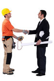 Architect and electrician shaking hands — Stock Photo