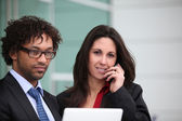 Closeup of a business couple standing outside — Stock Photo
