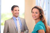 Young woman and real estate promoter — Stock Photo