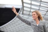 Businesswoman waving — Stock Photo