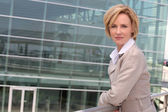 Businesswoman outside airport — Stock Photo