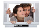 Couple inside a television set — Stock Photo