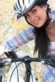 Woman riding her bike — Stock Photo