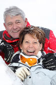 Senior couple having fun under snow — Foto de Stock