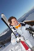 Peppy woman going skiing — Stock Photo