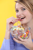 Young woman eating sweets — Stock Photo