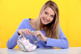 Gourmand woman eating marshmallows — Stock Photo