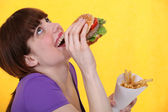Girl ecstatic over hamburger meal with fries — Foto Stock