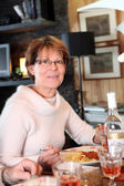 Woman eating pasta for dinner — Stock Photo