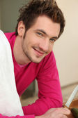 Young man cooking — Stock Photo