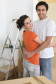 Couple hugging by ladder — Stock Photo