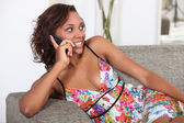 Sexy woman talking on her mobile phone — Stock Photo