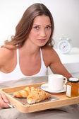 Brunet having breakfast in bed — Stock Photo