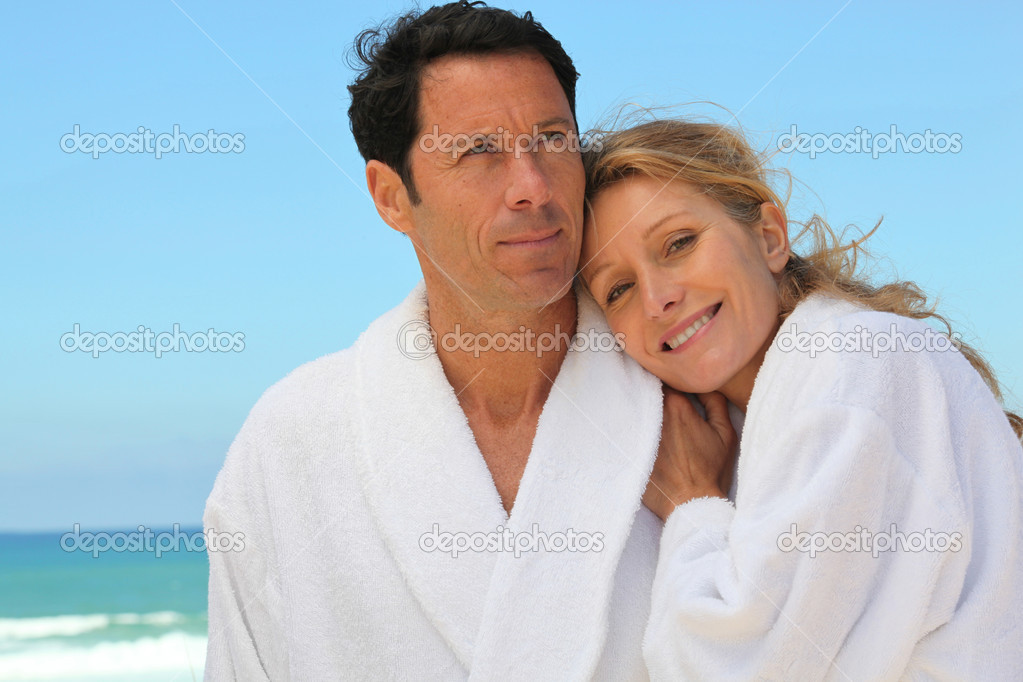Couple in robes on the beach  Stock Photo #7676007