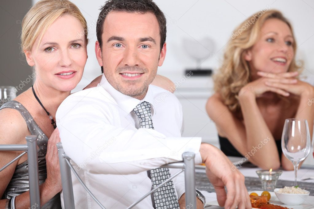 Couple at dinner party with friends — Stock Photo #7677364