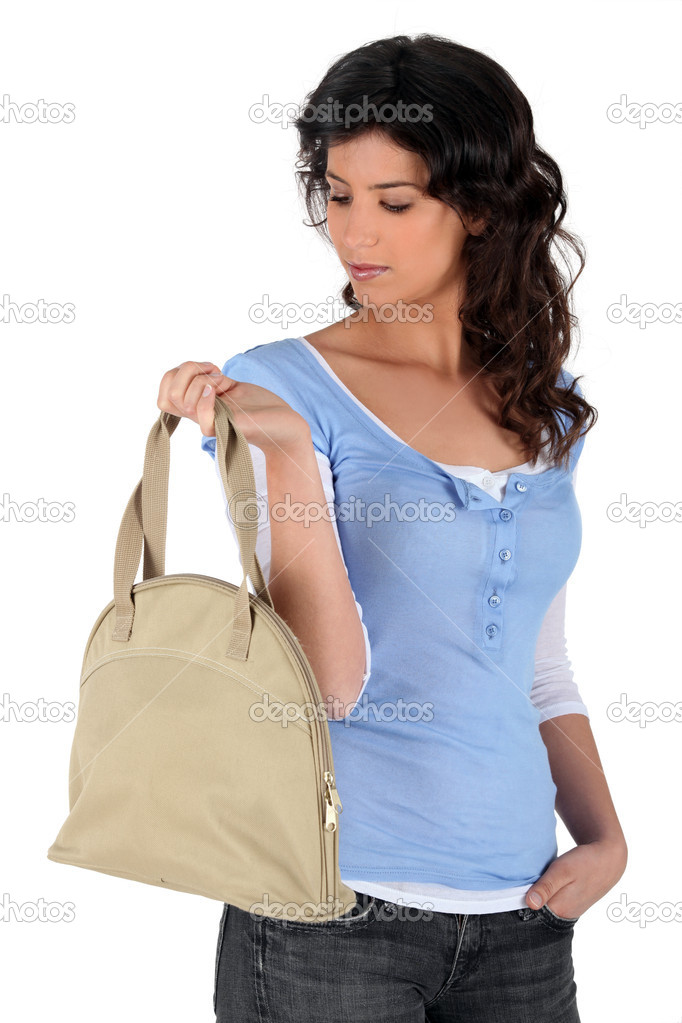 Portrait of a young woman with handbag  Stock Photo #7677761