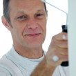 Stock Photo: Friendly decorator with a roller