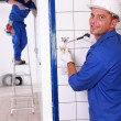Stock Photo: Duo of electricians indoors
