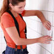 Young female electrician installing switch - Foto de Stock