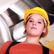 Woman in a hardhat - Stockfoto