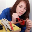 Red-haired girl working as plumber - Stockfoto