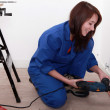Female labourer drilling hole in wall — Stock Photo #7692542