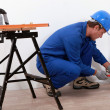 Stock Photo: Laborer with screwdriver and blowtorch