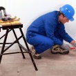 Plumber fitting copper pipes to a wall — Stock Photo