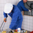 Two plumbers working — Stock Photo