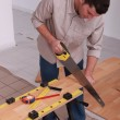 Handyman cutting a board — Stock Photo #7699183