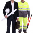 Tradesman and engineer standing side by side — Stock Photo