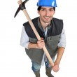 A manual worker with a pickaxe. — Stock Photo #7699825