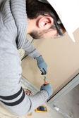 Man rearing house electrics — Stock Photo