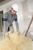 Builder insulating house — Stock Photo