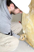 Wall insulation being installed by builder — Stock Photo