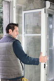 Worker installing French doors — Stock Photo