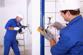 Repairmen in action — Stock Photo