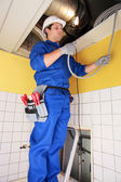 Electrician wiring a building — Stock Photo