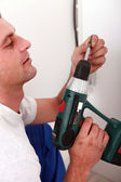 Close-up of a man with drill — Stock Photo