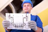 Laborer reading plan — Stock Photo