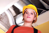 Woman in a hardhat — Stock Photo