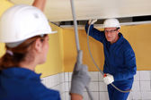 Tradespeople installing a heating system — Stock Photo