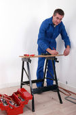 Man working on a workbench — Stock Photo